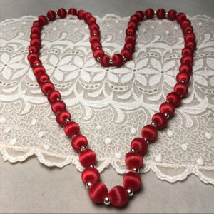 Vintage Jewelry - Vintage red satiny thread beaded necklace